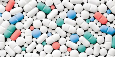 Lots of pills in mostly white, some red, blue, and green